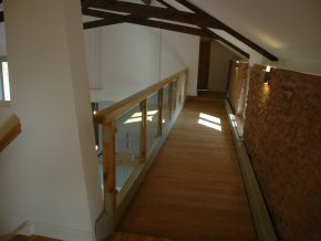 Upper walkway in barn conversion