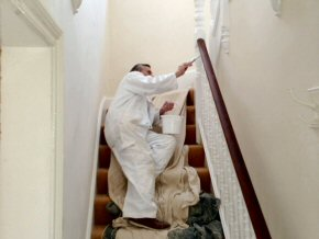 Painting balusters on stairway