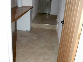 New tiled floor in utility area and hallway
